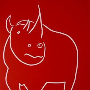 Rhino side on - Linocut, red ink, by Jane Bristowe